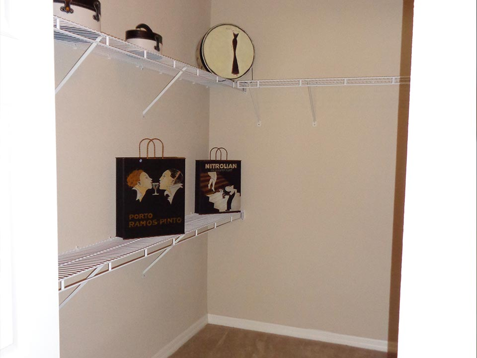 Photo Of A Gorgeous Apartment Master Bedroom Walk-In Closet.
